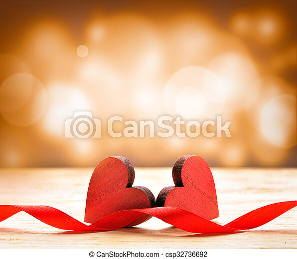 Wooden heart on brown background. Valentines Day.