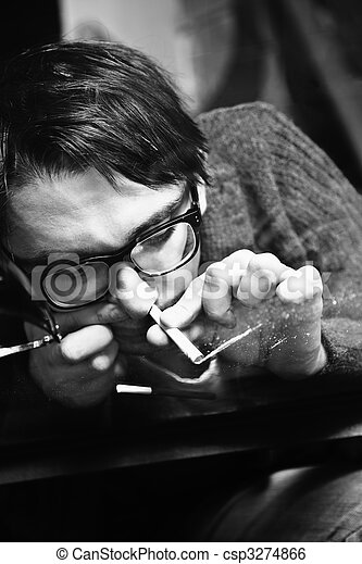 young man in glasses inhaling drugs - csp3274866