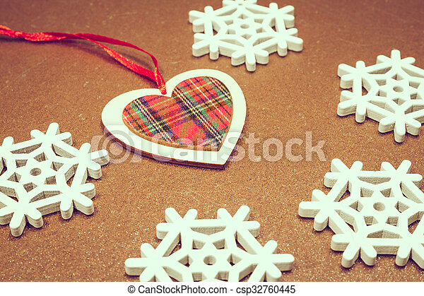 Christmas wooden ornaments toy heart with ribbon .
