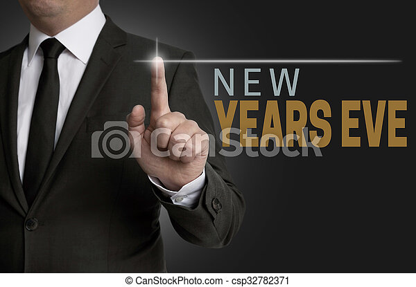 new years eve touchscreen operated by businessman concept