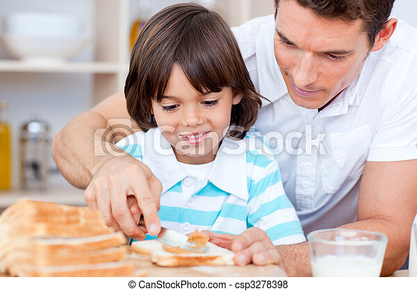Loving father and his son spreading jam on bread - csp3278398