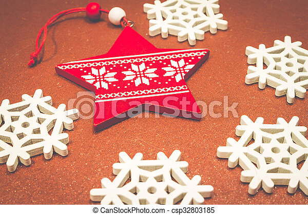Christmas wooden ornaments toy star with ribbon .