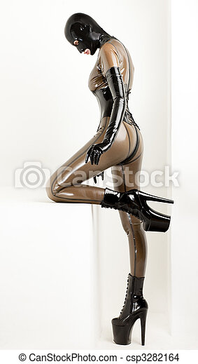 standing woman wearing latex clothes - csp3282164