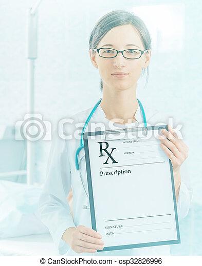 Doctor shows prescription paper - csp32826996