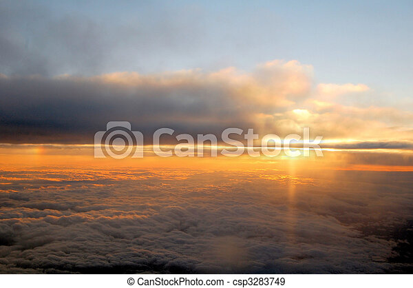 Sunrise and clouds viewed from above - csp3283749