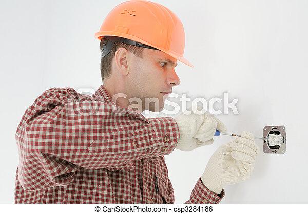 man installing electrical box - csp3284186