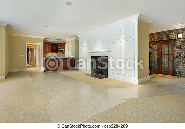 Basement with fireplace and bar - csp3284269