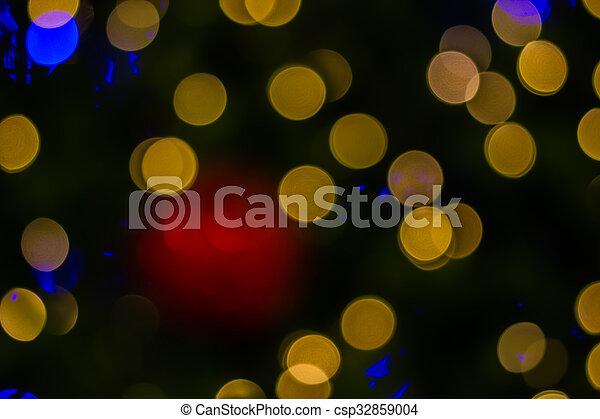 Defocused ligths of golden Christmas tree - csp32859004