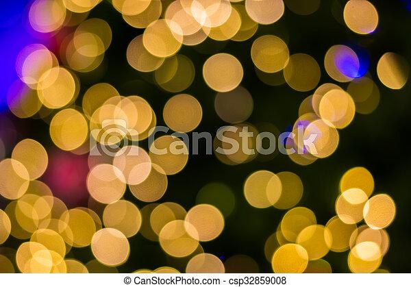 Defocused ligths of golden Christmas tree - csp32859008