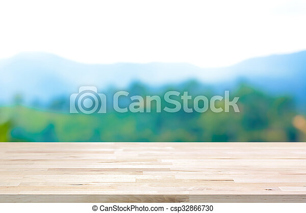 Wood table top on blur mountain background - can be used for display or montage your products