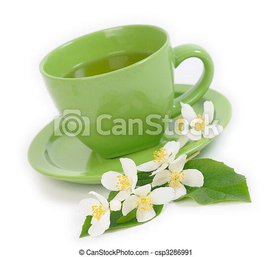 Green Tea with Jasmine flowers. Shallow DOF - csp3286991