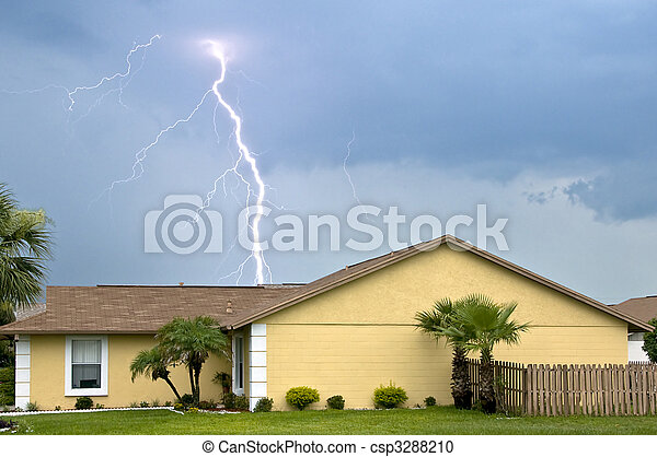 Massive daytime lightning strike near homes during afternoon storm - csp3288210