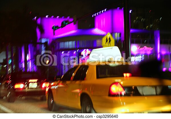 Yellow cab motion blur in Miami Beach  night city lights - csp3295640
