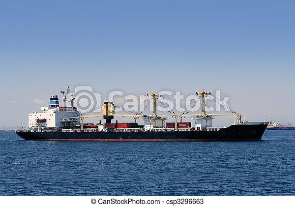 Cargo container freighter ship sailing in Mediterranean sea - csp3296663