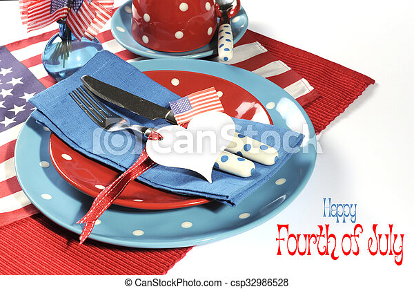 Happy Fourth of July dining table place setting in red, white and blue color theme with USA Stars and Stripes flag and heart gift tag with sample text.