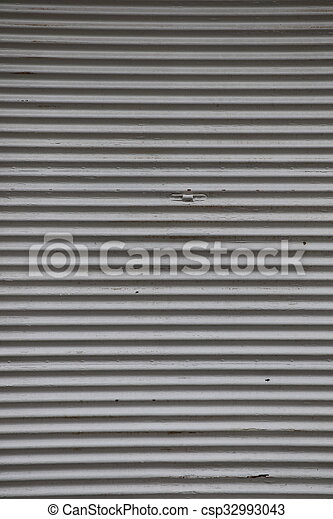 Old metal store shutters closed and shut up