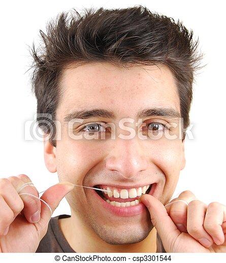 Man flossing his teeth - csp3301544