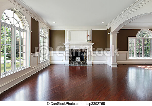 Living room with cherry wood flooring - csp3302768