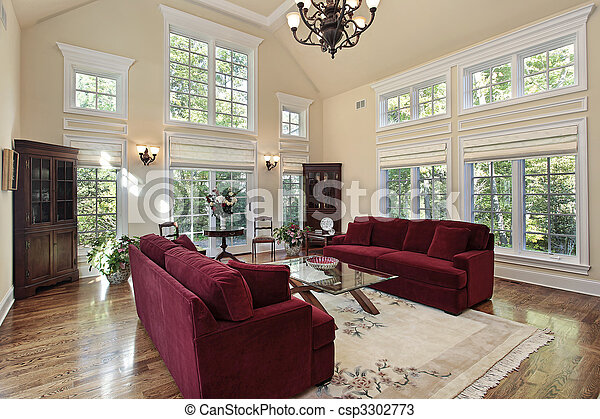 Living room with two story windows - csp3302773