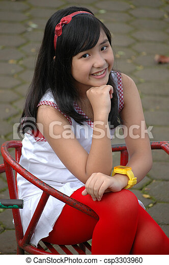 Stock Photography of little girl sit down in park - little ...
