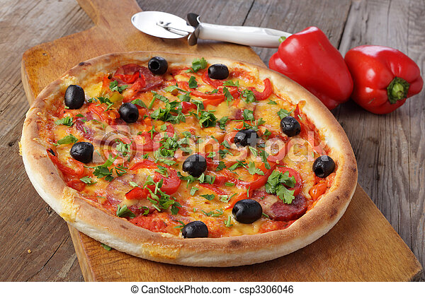 Pizza on wooden table - csp3306046