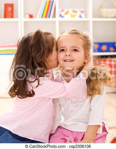 Little girls sharing a delightful secret - csp3306106
