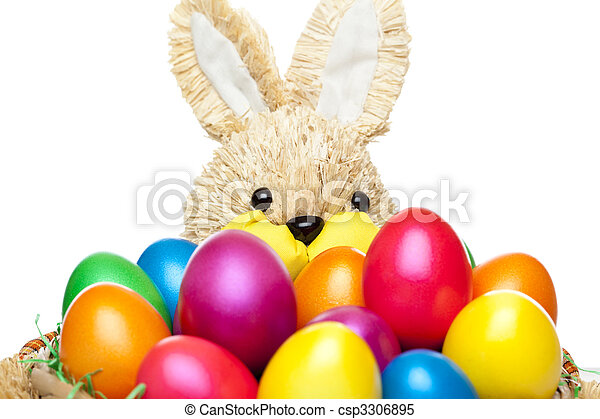 Easter bunny has basket full of colourful easter eggs - csp3306895