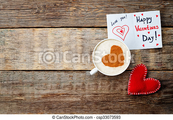 card for Valentines day, red toy heart and a cup of coffee on a dark wood background. toning. selective Focus