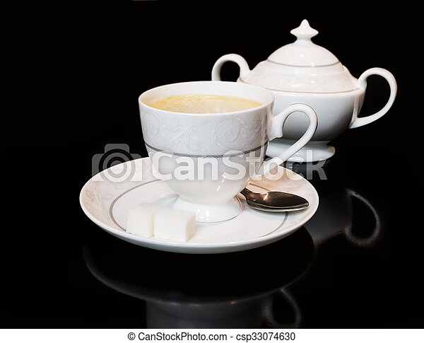 Cup of coffe and sugar bowl on black background - csp33074630