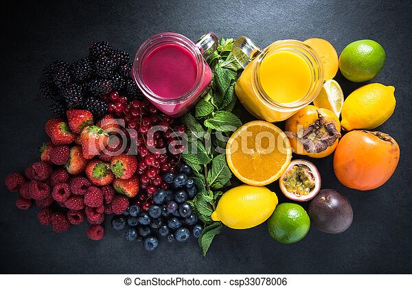 Tropical fruit and berries fruit smoothies with fresh fruits, diet concept