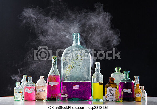 Magic spells in antique bottles - csp3313835