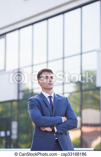 Portrait of a young businessman standing over blurred background  - csp33168186