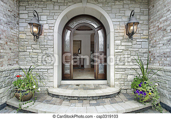 Arched stone entry to luxury home - csp3319103