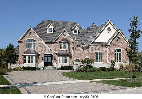 Luxury brick home with cedar roof - csp3319106