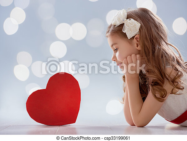 Happy Valentine\'s Day! Sweet child girl with red heart. Wedding and Valentine concept.