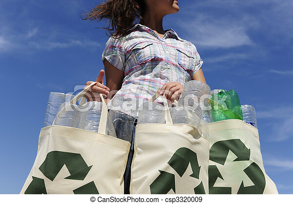recycling: woman holding bag with plastic bottles - csp3320009