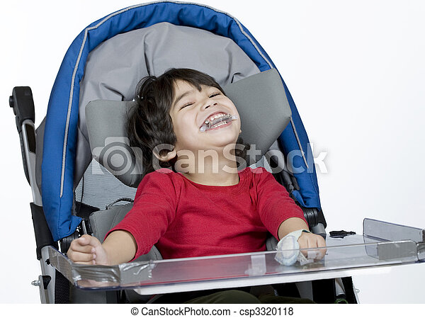 Three year old disabled boy in medical stroller - csp3320118