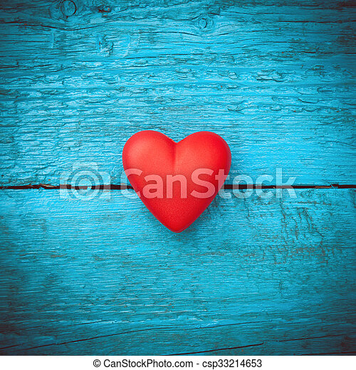 Valentine day. Red heart on the blue boards. Valentine\'s Day. Heart pendant. Red heart. Space for text. Eighth of March. International Women\'s Day. Toned image.