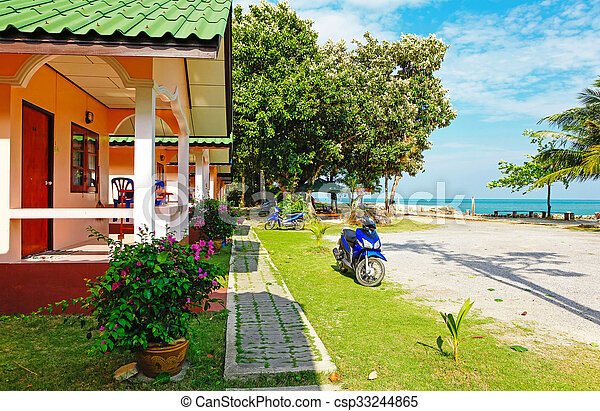 house by the sea with scooter outdoors - csp33244865