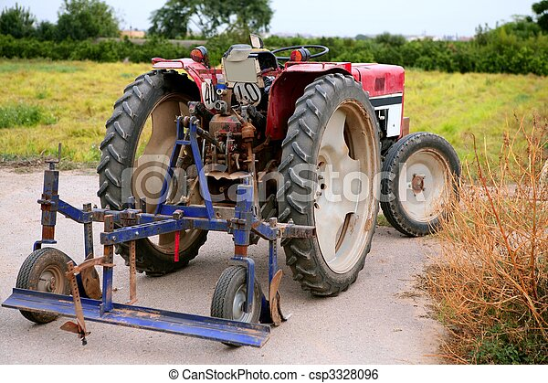 Agriculture aged red tractor  retro vintage machine - csp3328096