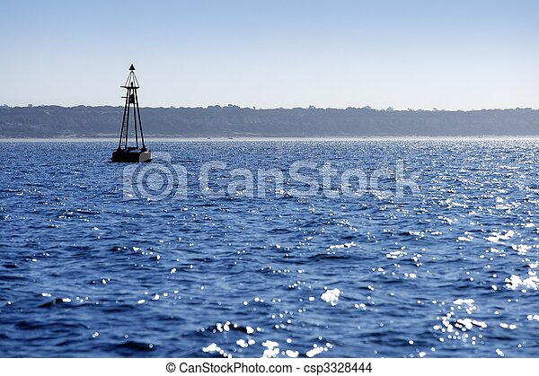 Beacon floating on blue ocean as guide help - csp3328444