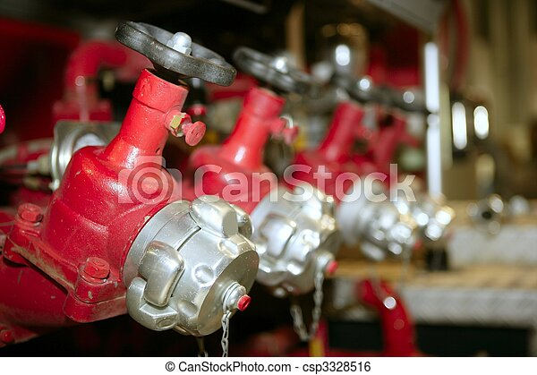 fire truck hose faucets in a row - csp3328516
