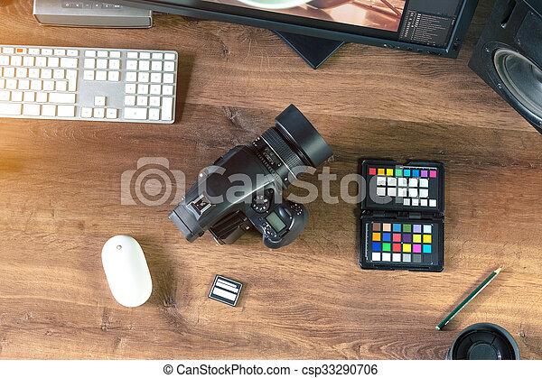 Top view Desktop shot of a modern Digital Medium Format Photo Camera with Laptop on stylish wooden desktop workplace / Background