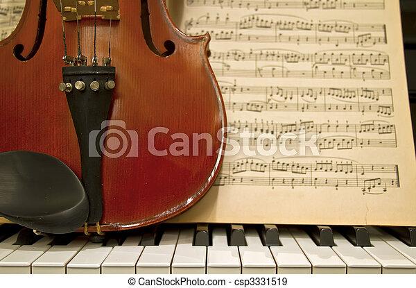Violin Piano Keys and Music Sheets - csp3331519