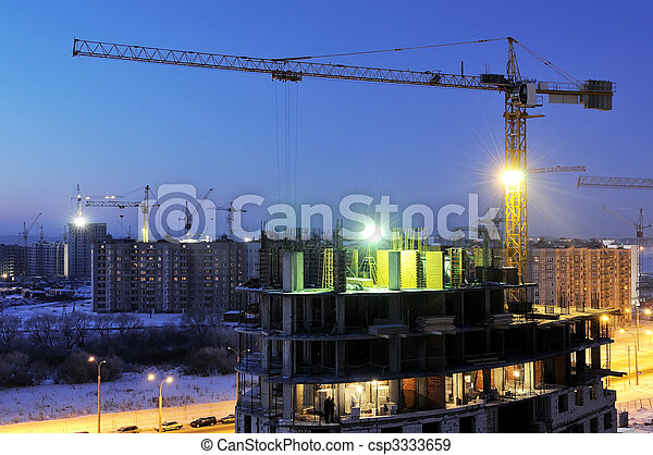 crane loader at night construction site - csp3333659