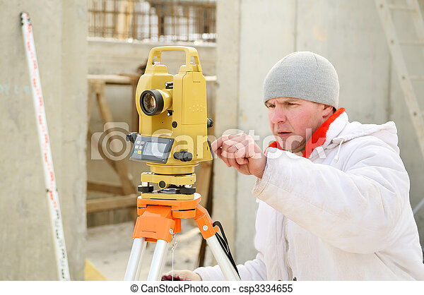 surveyor worker at construction site - csp3334655