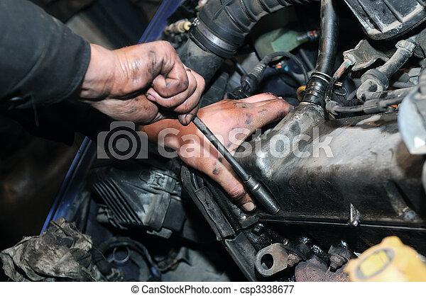 mechanic repairman at car repair work - csp3338677