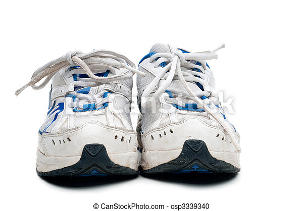 A pair of old worn athletic sports shoes on a white background - csp3339340