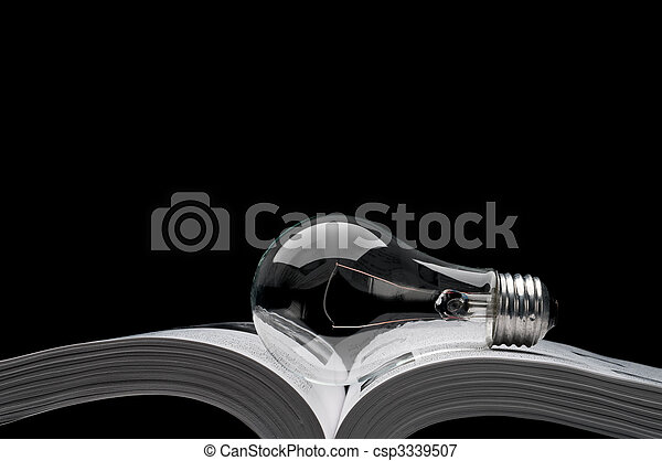 a light-bulb on a book showing ideas from inspiration and education - csp3339507