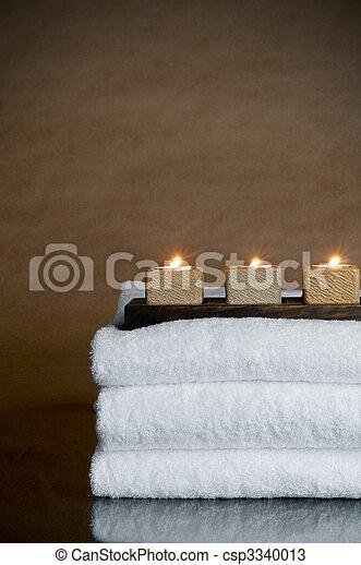 Three candles on three spa towels - csp3340013